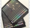 Vågiga stripes i silver/rainbow effekt